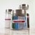 """3.4375"""" x 0.669"""" rectangular labels on aggressive white matte used to label glass jars for organization"""