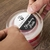 """Round 3"""" circle on aggressive white matte label material being applied to the lid of a candle jar"""