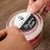 """Round 3"""" circle on standard white matte label material being applied to the lid of a candle jar"""