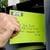 "1.75"" x 0.5"" standard white matte return address label on neon envelope"