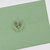 "1.67"" circle label on clear gloss laser applied to green envelope as envelope seal"