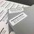 "2.62"" x 1"" white matte address label on gray envelope"