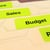 Neon yellow label printed from a home/office printer for file folder labeling