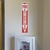 Fire extinguisher arrow safety sticker above fire extinguisher.