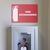 Fire extinguisher safety sticker above fire extinguisher.